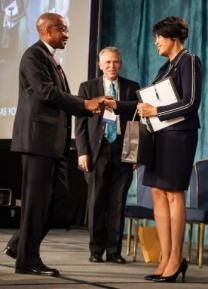 Mayor Stephanie Rawlings-Blake (right) shakes hands with United Methodist Bishop Marcus Matthews (left) while Jim Williams looks on. Mayor Rawlings-Blake spoke at the 2015 Baltimore-Washington Annual Conference. Photo by Tony Richards, courtesy of the Baltimore-Washington Conference.