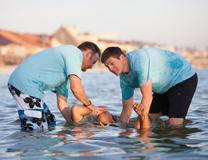 Baptism in Gulf waters of United States.