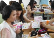 Students in ESL class make Mother's Day cards, snapping a photo with a cell phone. Photo courtesy of blogger, ConnieinChina.