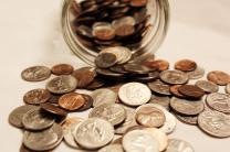 Coins collected through the year can be used in a Lent coin calendar. Photo by Kathryn Price, United Methodist Communications.