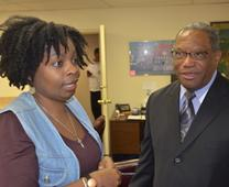 The Rev. Cynthia Moore-Koikoi, left, superintendent of the Baltimore Metropolitan District, speaks with the Rev. Cordell Hunter, Presiding Elder of the Eastern District of the African Methodist Episcopal Church, at Bethel AME in Baltimore. Photo by Erik Alsgaard, courtesy the Baltimore-Washington Conference.