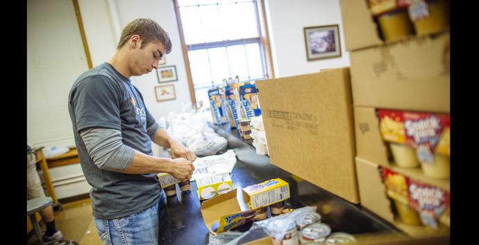 Dakota Wesleyan University senior Brent Matter volunteers for the Weekend Snack Pack Program to provide easy-to-prepare meals to help children who primarily stay home alone on the weekends have something nutritious to eat. Photo courtesy of Dakota Wesleyan University.