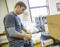 Dakota Wesleyan University senior Brent Matter volunteers for the Weekend Snack Pack Program. Photo courtesy of Dakota Wesleyan University.