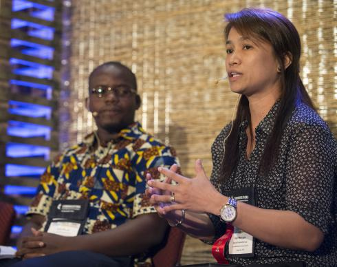 April Grace Gonzaga-Mercado (right) and Isaac Broune lead a panel discussion on using communications as aid as part of the Game Changers Summit at the Opryland Hotel in Nashville, Tenn. Photo by Mike DuBose, UMNS, 2014.