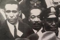 The Rev. Gil Caldwell walks with MLK at a rally in Boston in 1958. Courtesy: the Rev. Gil Caldwell.