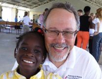Gil Hanke meets with Joulie who had just been fit with new hearing aids from Hear the World Foundation. Photo courtesy United Methodist Men.