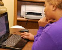 A woman uses a computer in housing provided to help homeless get back on their feet. Photo by Jessica Brodie, South Carolina United Methodist Advocate.