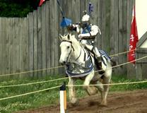 The Rev. Gene Martino, Jr. rides his horse Jacques in jousting tournament at Tennessee Renaissance Festival. Still from video by Andrew Jensen, United Methodist Communications. May 2014.