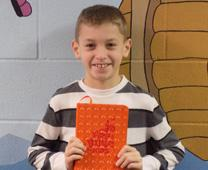 Fourth-grader Colyn Chris regularly brings his new Bible to Sunday school at Faith United Methodist Church in Goshen, Ind. Photo courtesy of Faith United Methodist Church, Interpreter Magazine.