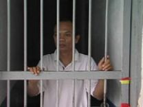 Image of imprisoned man. Photo by the Rev. Rinaldy Damanik, courtesy GBOD.