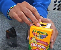 Crayons are a part of UMCOR's school kits for children. Screen grab from video, courtesy of UMCOR.