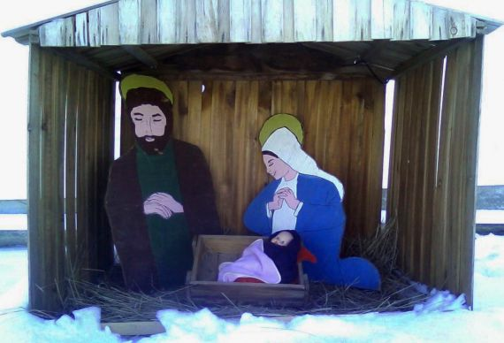 A manger scene created 35 years ago by Terry Pettengill's Sunday school class graces the outside of Stetson United Methodist Church in Patten, Maine. Church member Rodney Harris, who passed away  earlier this year, built the creche in his wood shop. Photo by Ruth Foss.