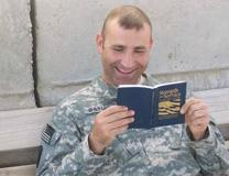 A solider reads 'Strength for Service' devotional book. Photo courtesy United Methodist Men.