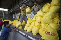 Volunteers load a truck at the offices of the United Methodist Committee on Relief in Manila with relief supplies for survivors of Typhoon Haiyan in the Philippines. Photo by Mike DuBose, United Methodist News Service.