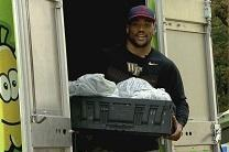 Wake Forest University football captain Brandon Chubb loads the truck for H.O.P.E. a feeding and mentoring program for children.