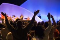 Participants raise their hands in praise during worship at the United Methodist Women's Assembly, 2014. Photo by Mike DuBose, United Methodist News Service.