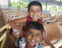 These two children in India were born HIV-free, thanks to a clinic in Namakkal that was initially started with a grant from the United Methodist Global AIDS Fund. Photo courtesy of Don Messer.