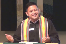 The Rev. DJ del Rosario preaches at Bothell United Methodist Church in Bothell, Wash. Video still, courtesy of Bothell United Methodist Church.
