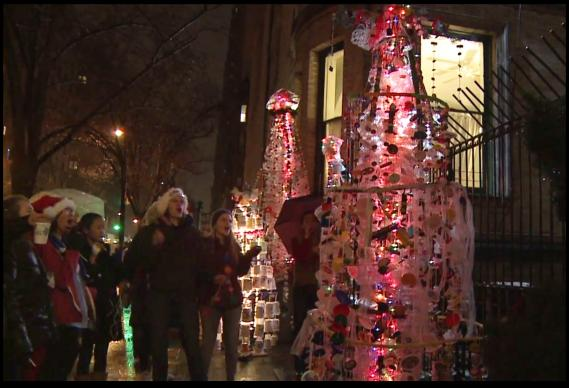 Outside New York's Church of St. Paul and St. Andrew United Methodist, people react to the church's 'trash trees.' The church's 2012 Christmas project used recycled items to encourage viewers to think green all year around. Screen grab from video, UMTV: Trash Trees for Christmas.