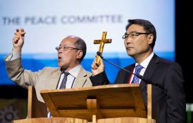 The Revs. James Chongho Kim (right) and Kun Sam Cho hold crosses symbolizing the two Koreas, during a report from the Committee on Peace by the Korean Association of the United Methodist Church May 19 at the 2016 United Methodist General Conference in Portland, Ore. File photo by Mike DuBose, UMNS.