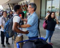 United Methodist missionary Tawanda Chandiwana (left foreground) is embraced by Thomas Kemper, head of the denomination's Board of Global Ministries, at the Ninoy Aquino International Airport in Manila, Philippines, after Chandiwana was released from a detention center and allowed to leave the country. Photo courtesy of Thomas Kemper, GBGM.
