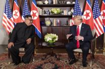 North Korean leader Kim Jong Un (left) speaks with President Donald Trump during their summit meeting at the Capella Hotel in Singapore. Photo courtesy of Dan Scavino Jr., Wikimedia Commons.