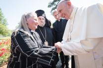 United Methodist Bishop Mary Ann Swenson, vice-moderator of the World Council of Churches Central Committee,  greets Pope Francis in Geneva, Switzerland. Photo by Albin Hillert, WCC.