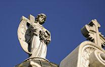 An angel in the Recoleta Cemetery located in Buenos Aires, Argentina. The cemetery is located at the church of Our Lady of Pilar. Photo by Godot13, courtesy Wikimedia Commons.