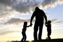 Photo shows dad with children. Courtesy of Phillip Davis Ministries.