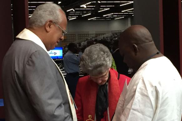 During breaks at General Conference, bishops are praying with others in the lobby of the Oregon Convention Center. Photo by Joe Iovino, United Methodist Communications.
