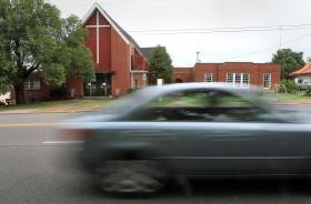 Car drives past West Nashville UMC