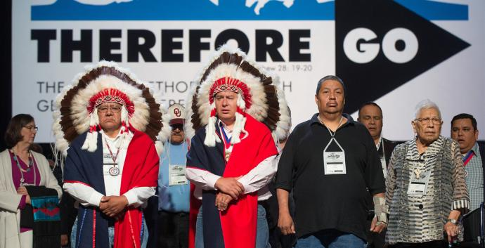Representatives of the Cheyenne and Arapaho tribes are recognized  at the 2016 General Conference, where delegates heard about the 1864 Sand Creek Massacre. Photo by Mike DuBose, United Methodist Communications.