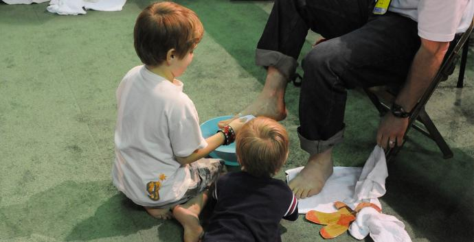 Foot washing is an important symbol of Holy Week in which children can participate. File photo by John C. Goodwin, United Methodist Communications.