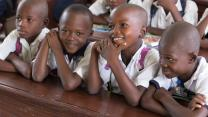 Students laugh in a classroom in East Congo. Photo by Mike DuBose, United Methodist News Service.