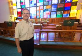The Rev. Darryl Tate in the rebuilt sanctuary at St. Luke's UMC.