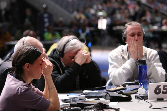 Delegates pause for moments of prayer during legislative sessions. These  prayers are often led by the presiding bishop. Photo by Kathleen Barry, United Methodist Communications.
