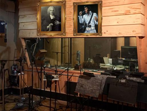 Portraits of famous lyricist Charles Wesley and famous singer Elvis Presley hang inside Son Studios. Photo illustration by Christopher Patrick.