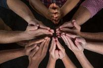 Hands in prayer. Photo illustration by Kathleen Barry, United Methodist Communications.