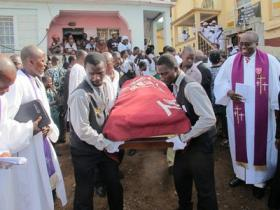File photo from the funeral of the Rev. Isaac Momoh Ndanema in Sierra Leone.