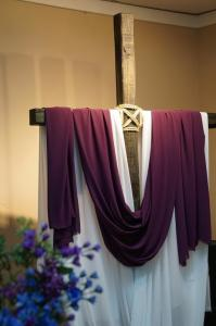 Cross draped in purple for Lent.