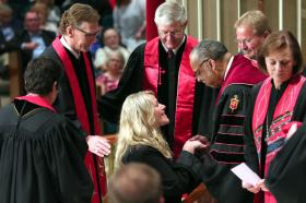 Bishop Robert Hayes ordained a father and daughter during the same service.