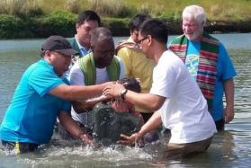 A river baptism in the Philippines.