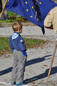 A child stands near a flag during an Operation Salute event.