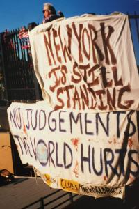 """Banner posted soon after 9-11-2001 that reads, """"New York is still standing."""""""