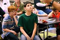 Students listen during a VBS session led by members of St. Paul UMC in Abilene, Texas. Video image by United Methodist Communications.