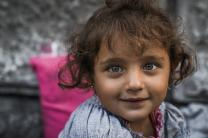 Like many refugees, this Syrian girl photographed in front of Budapest Keleti Railway Station on September 3, 2015, is far from home. Photo by Mstyslav Chernov [CC BY-SA 4.0 (http://creativecommons.org/licenses/by-sa/4.0)], via Wikimedia Commons.
