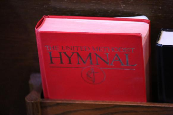 Hymnals in pews at West End United Methodist Church. Photo by Steven Kyle Adair, United Methodist Communications.
