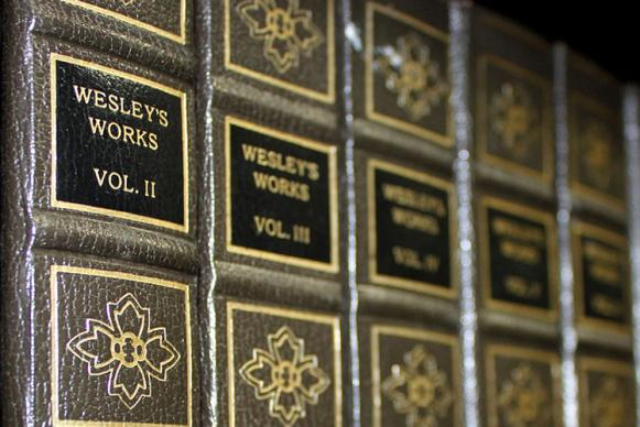 Multi-volume edition of Wesley's Works. Photo illustration by Kathryn Price, United Methodist Communications.