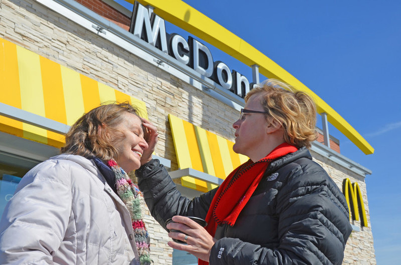 Imposition of ashes outside of a McDonald's.