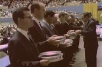 Communion servers during the historic worship service at the Uniting Conference for the founding of The United Methodist Church. Image from historic footage from the conference, courtesy of the United Methodist Commission on Archives and History.
